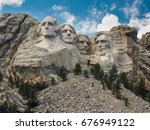 Mount Rushmore With A Blue Sky...