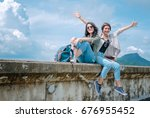 happy tourist asian couple... | Shutterstock . vector #676955452