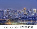 twilight city tower building... | Shutterstock . vector #676993552