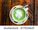 hot green tea cup  on vintage... | Shutterstock . vector #677010625
