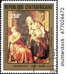 """Small photo of Central African Republic - CIRCA 1981: A stamp shows painting artist Rembrandt """"Tobit Accusing Anna of Stealing the Kid"""""""