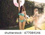 young women wearing bikini... | Shutterstock . vector #677084146