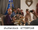 family are having christmas... | Shutterstock . vector #677089168