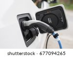 loading an electric car | Shutterstock . vector #677094265