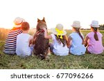 Stock photo four young caucasian kids one adult female and wolf dog sitting 677096266