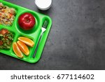 Stock photo serving tray with delicious food on table concept of school lunch 677114602