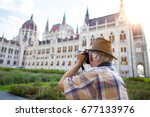 pensioner tourist capturing... | Shutterstock . vector #677133976