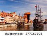 Vintage ships (pirate caravels) sailing on Motlawa river with historic port Crane in Old Town on background. Gdansk, Poland.