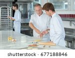 apprentices bakers in school... | Shutterstock . vector #677188846
