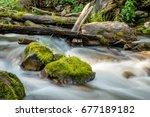 Mossy Rocks In River