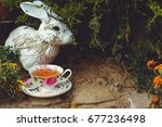 Stock photo mad tea party adventures in wonderland white rabbit drink from cups under giant mushrooms 677236498