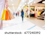 woman with shopping bags in... | Shutterstock . vector #677240392