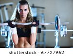 Weight training young woman portrait. - stock photo