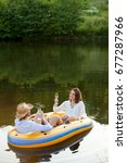couple in dinghy on a country... | Shutterstock . vector #677287966