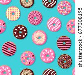 donut seamless pattern. pink ... | Shutterstock .eps vector #677308195