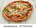 food. delicious pizza on the... | Shutterstock . vector #677314312