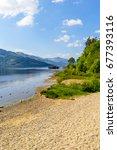loch lomond at rowardennan ... | Shutterstock . vector #677393116