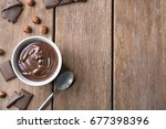 bowl with delicious chocolate... | Shutterstock . vector #677398396