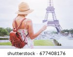tourist looking at the map of...   Shutterstock . vector #677408176