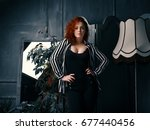 ginger girl at home next to the ... | Shutterstock . vector #677440456