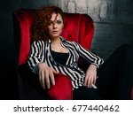 woman siting on red chair in... | Shutterstock . vector #677440462
