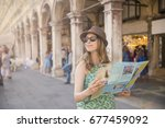 cheerful woman wanderer with... | Shutterstock . vector #677459092