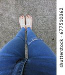 close up of bare feet with red... | Shutterstock . vector #677510362