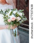 bouquet in the hands of the... | Shutterstock . vector #677537638