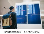 a young male traveler with a... | Shutterstock . vector #677540542