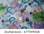 singapore dollars bill and coins | Shutterstock . vector #677549038