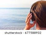 young beautiful girl listening... | Shutterstock . vector #677588932