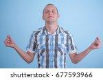 portrait man  eyes closed  in... | Shutterstock . vector #677593966