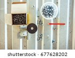 Small photo of Closeup of roofing screw and screw for metal work on white background,with clipping path.