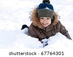 A Little Boy In The Snow