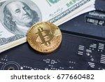 close up shot gold bitcoin on... | Shutterstock . vector #677660482