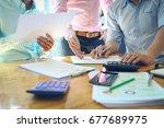 business team meeting present... | Shutterstock . vector #677689975