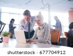 two business people using... | Shutterstock . vector #677704912
