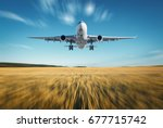 airplane with motion blur... | Shutterstock . vector #677715742