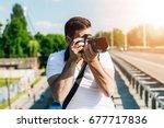 photographer is taking photo on ... | Shutterstock . vector #677717836