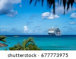 cruise ship in crystal blue... | Shutterstock . vector #677773975