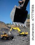 open pit coal mine. loading... | Shutterstock . vector #677778586