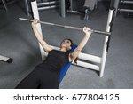 young beautiful woman doing... | Shutterstock . vector #677804125