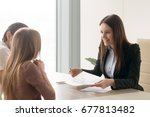 smiling real estate agent... | Shutterstock . vector #677813482