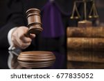 Small photo of Judge, male judge in a courtroom striking the gavel