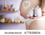 pregnant woman holding baby... | Shutterstock . vector #677838856
