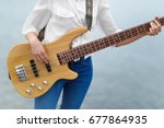 Playing The Bass Guitar. The...