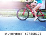 the girl rides a bicycle in the ... | Shutterstock . vector #677868178