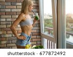 fit woman drinking vegetable... | Shutterstock . vector #677872492
