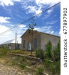 Small photo of Old Grey Adobe House Agave West Texas Small Town Desert