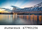 Stock photo howrah bridge the historic cantilever bridge on the river hooghly with twilight sky howrah 677901256